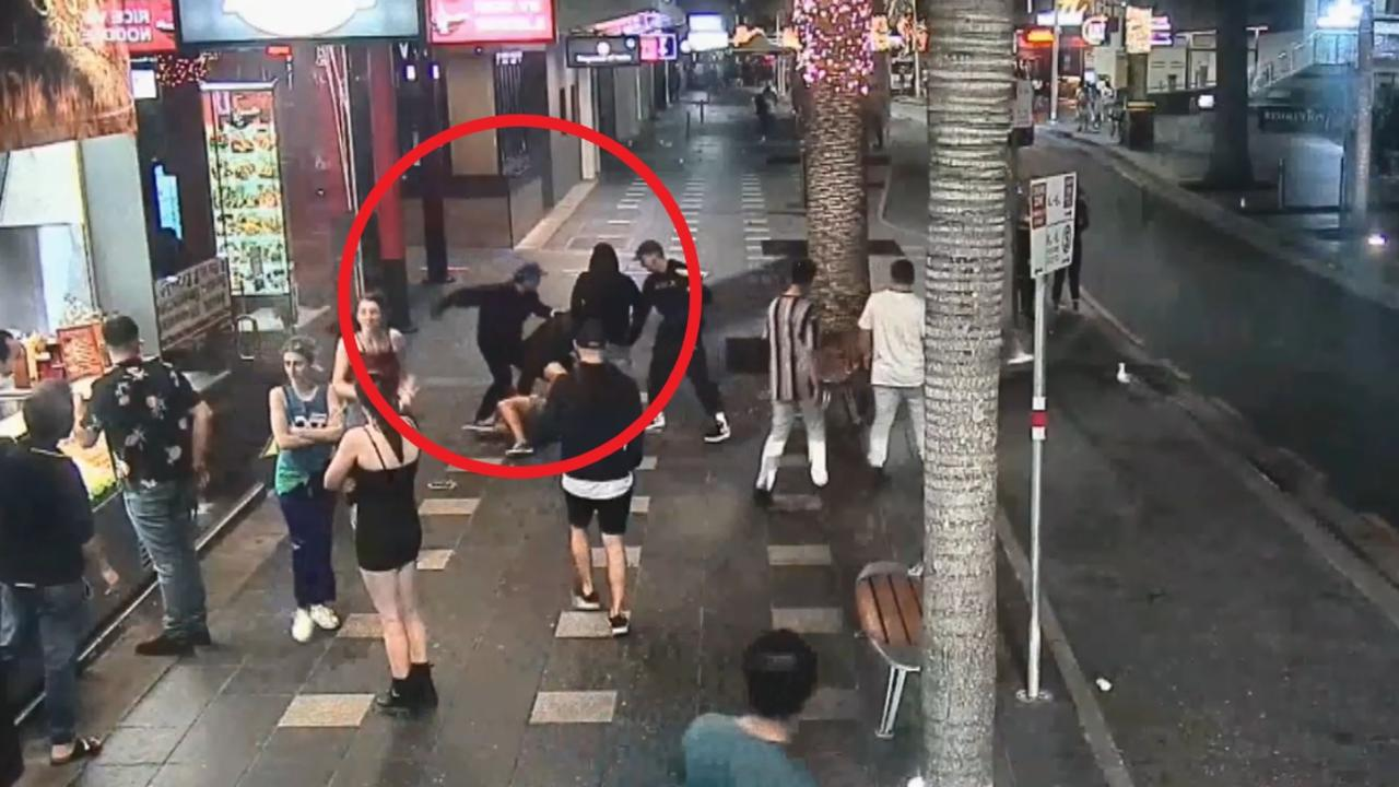 Ivan Susin, 29, can be seen throwing a punch after intervening, before he is knocked out cold. Gold Coast Surfers Paradise fight assault. Picture: 9News