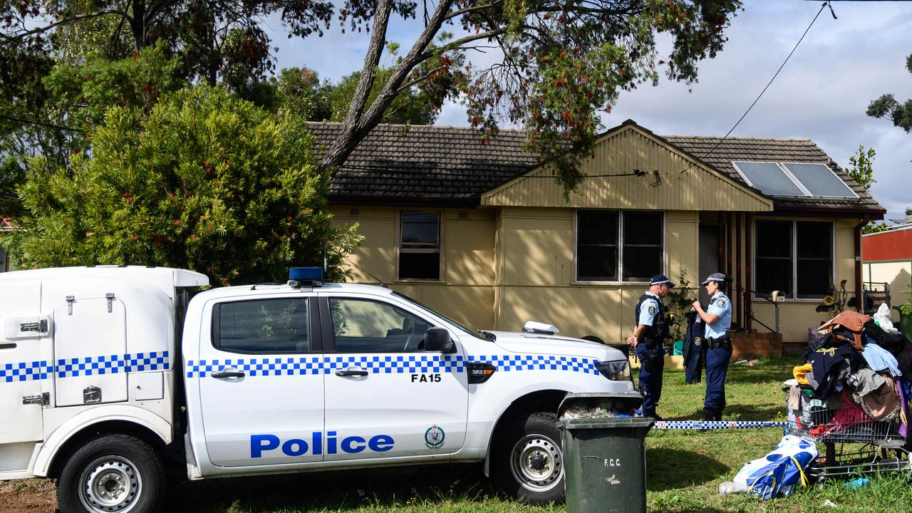 Police outside the house where the man died. Picture: James Gourley