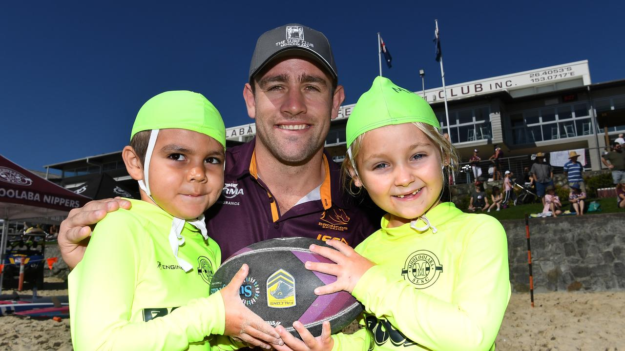 Mooloolaba nippers Noah Henderson and Matilda Pelletier get some tips off Broncos hooker Andrew McCullough.