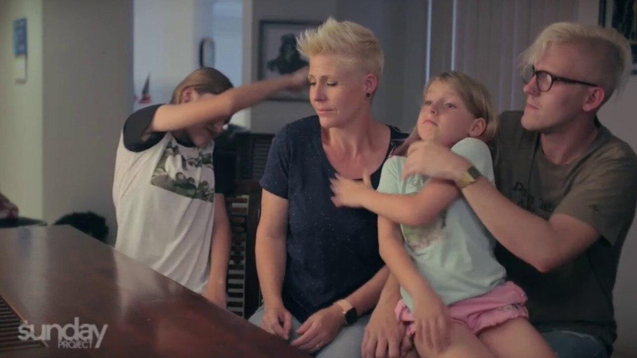 The girls involuntarily slap their mum.