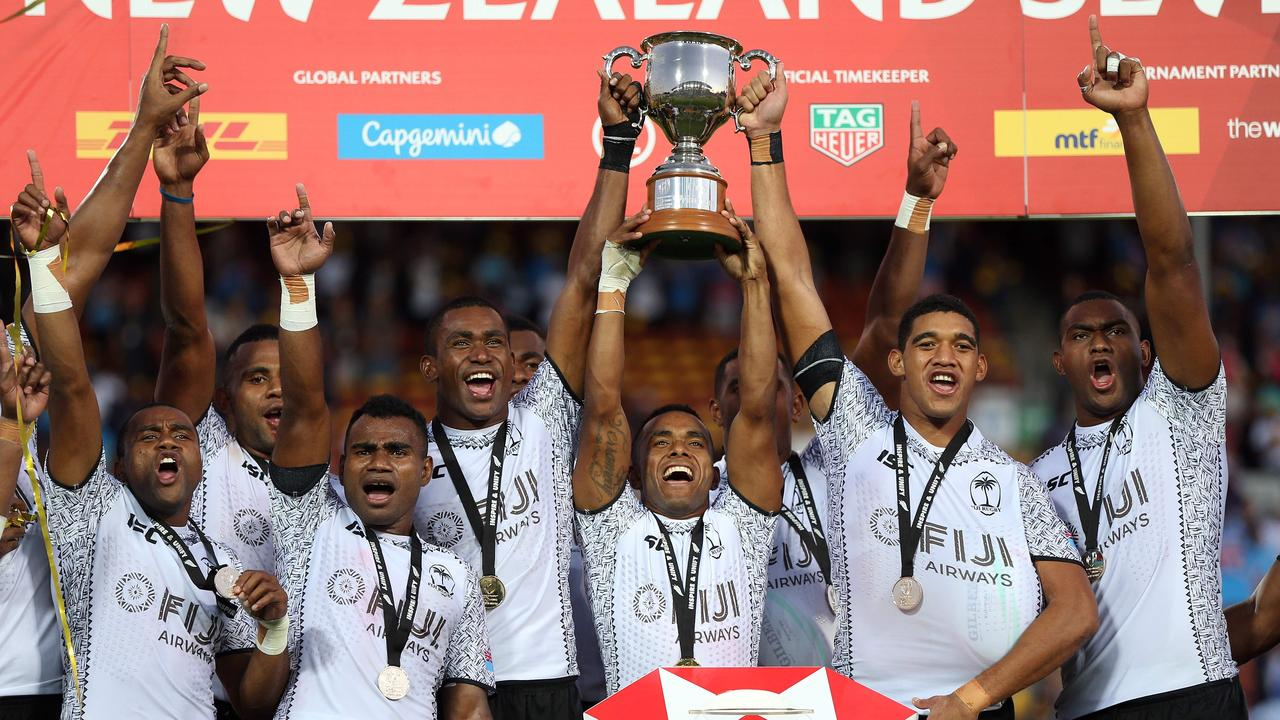 Fiji players celebrate with the trophy after winning the cup final of the World Rugby Sevens Series match between the US and Fiji at Waikato Stadium in Hamilton on January 27, 2019. (Photo by MICHAEL BRADLEY / AFP)