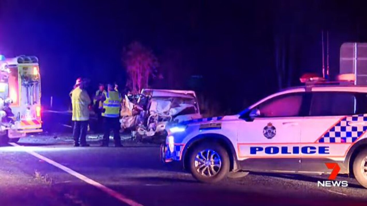 TRAGEDY: Emergency services workers at Saturday's crash on the Bruce Highway at Kolonga.