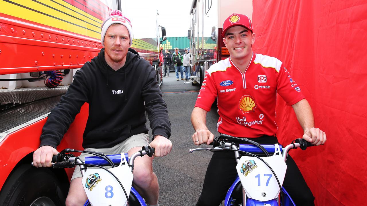 Richmond star Jack Riewoldt and Scott McLaughlin meet up in pit lane at Bathurst. Picture Rohan Kelly.