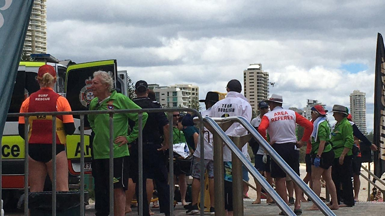 Spectators gather around as paramedics work on a woman who was pulled from the water during the Coolangatta Gold. Picture: Supplied