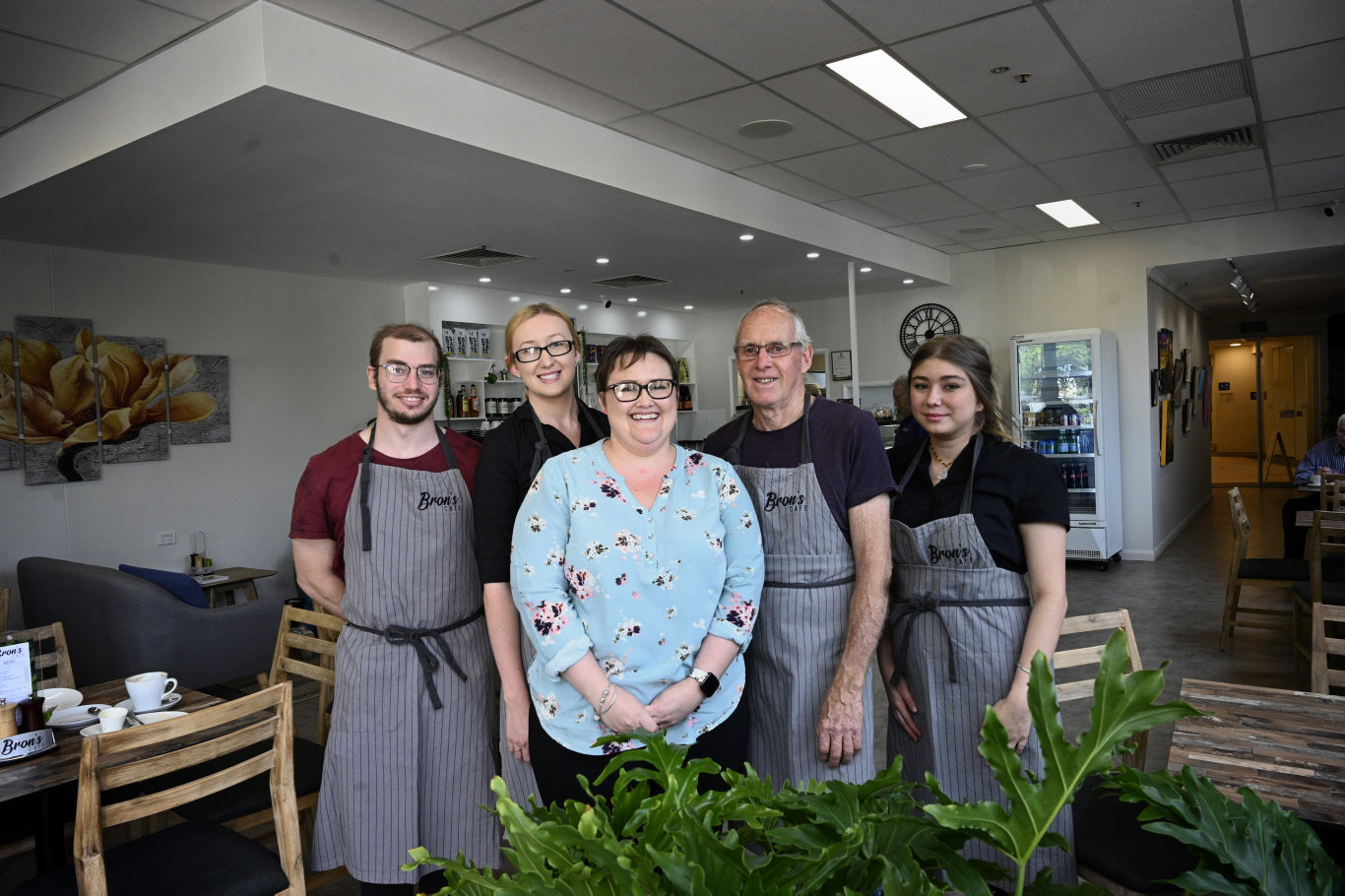 Owners and staff, from left; Tim Armstrong (cook), Tiffany Dew (manager), , owners Myf Levingston and her father Terry Harris and staff member Kyiesha Woolford. Bron 's Cafe opens in Medici Centre. Photo Bev Lacey