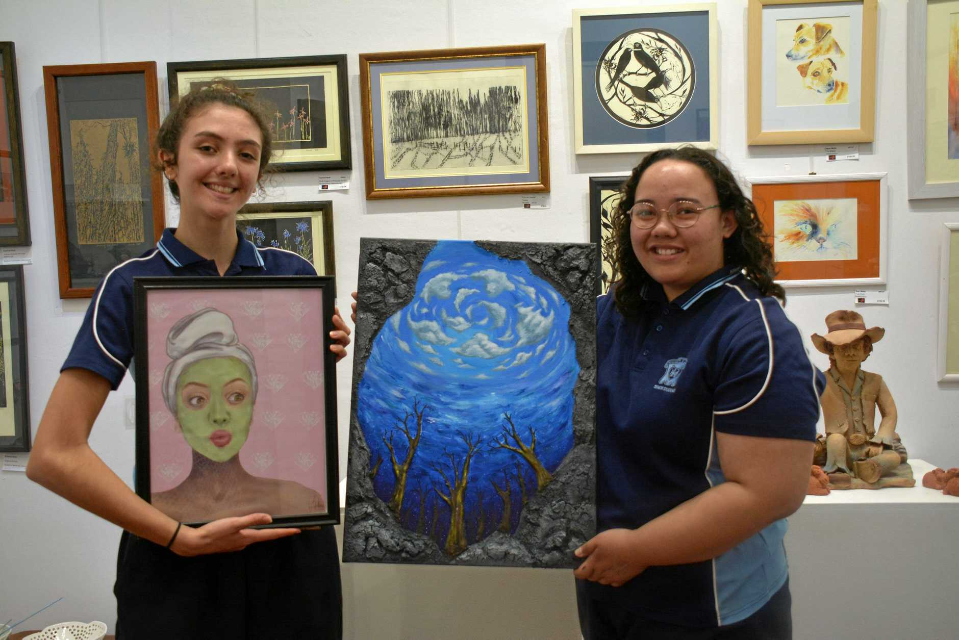 YOUNG ARTISTS: Amber Fitz-Herbert and Noelana Rossow with their artworks.