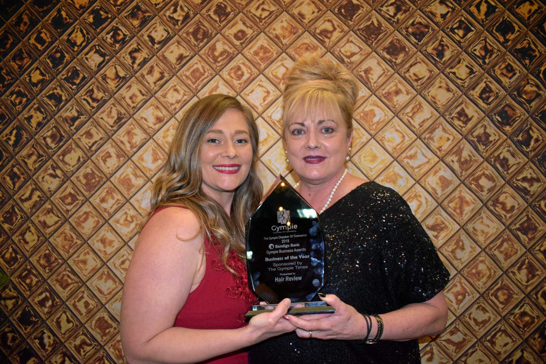 TOP PRIZE: Jamie Jack and Carolann Verity from Hair Review won the Business of the Year title at the Gympie Chamber of Commerce Business Awards at the Civic Centre on Saturday night.
