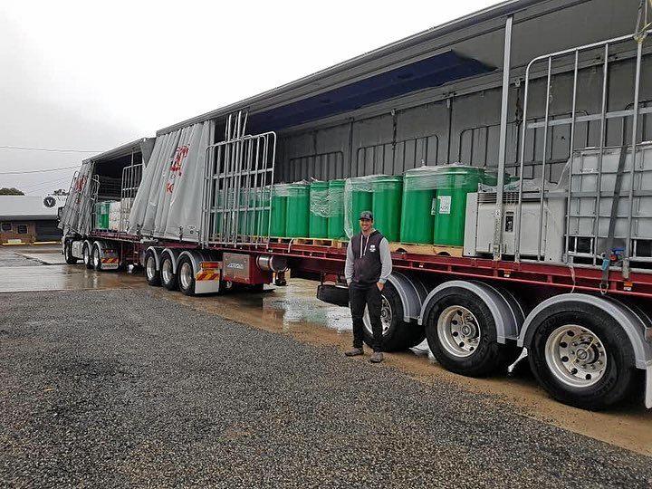 WATER DONATION: Brad Costigan donates water to the Granite Belt.