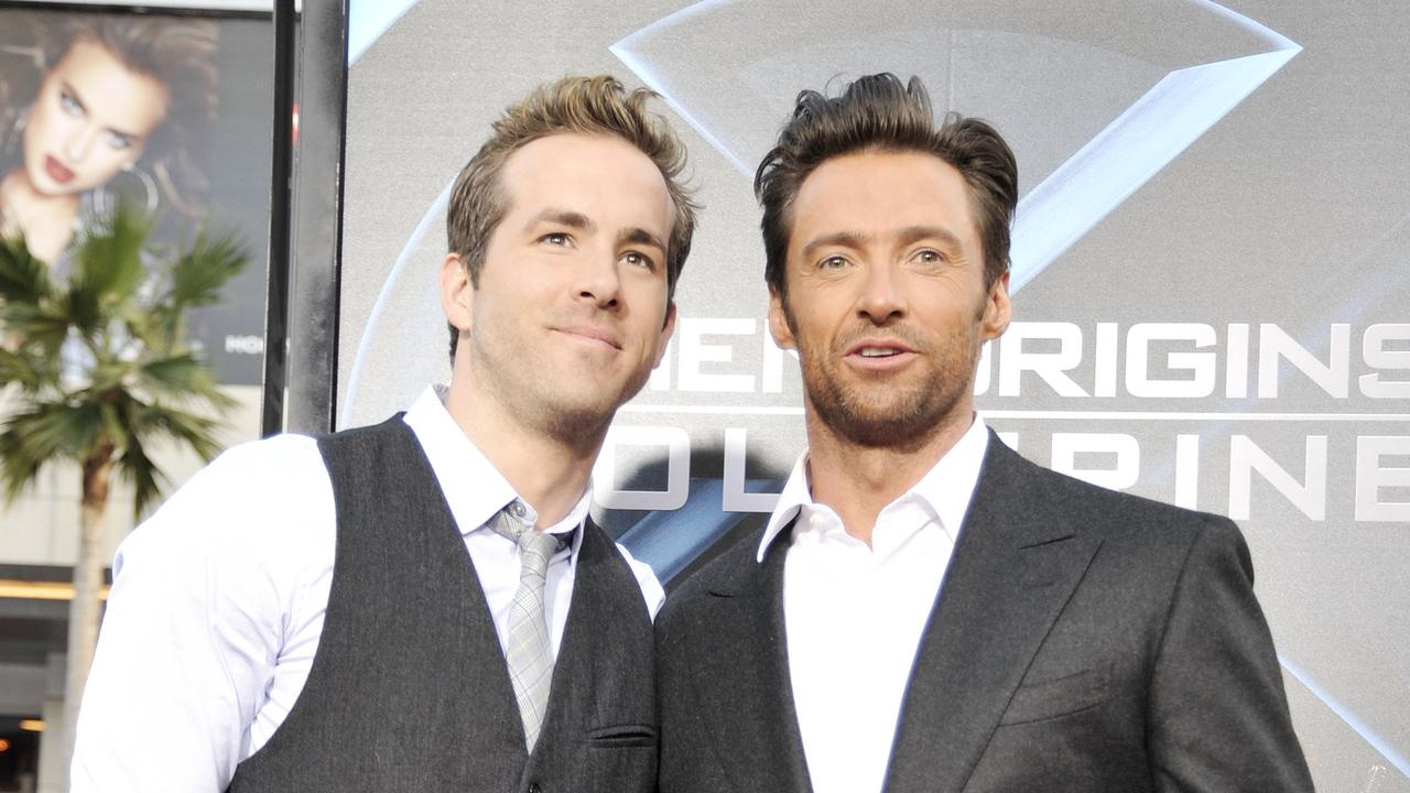 Reynolds (left) and Jackman: They're friends, really (we think). Picture: Kevin Winter/Getty