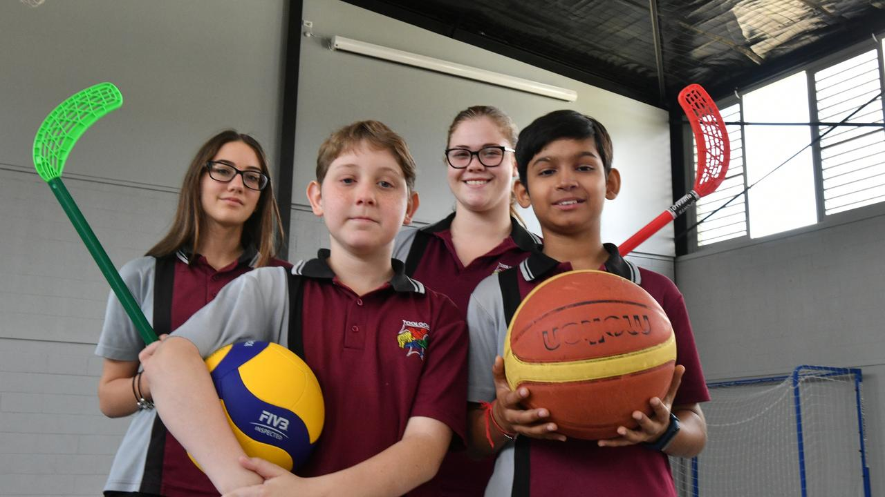 Poppy Longden, Ismari Van Der Westhuizen (front) Tanveer Salaria and Michael Steveno at Toolooa State High School's newest building.