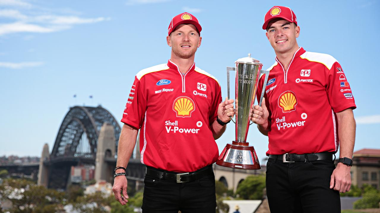 Alex Premat and Scott McLaughlin pose with the Peter Brock trophy at Observatory Hill in Sydney following their Bathurst 1000 victory. Picture: Adam Yip