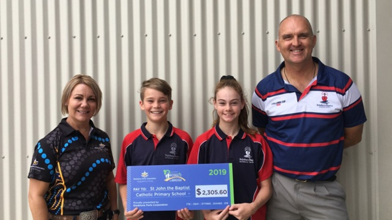 DONATE: People, Community and Sustainability General Manager Rowen Winsor awards St John the Baptist student Principal, Mr Emerick and student leaders with B2B funds raised.