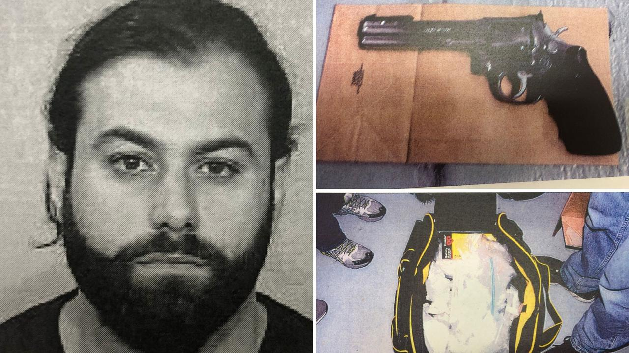 Makdissi with one on the firearms and bags of drugs found at his home
