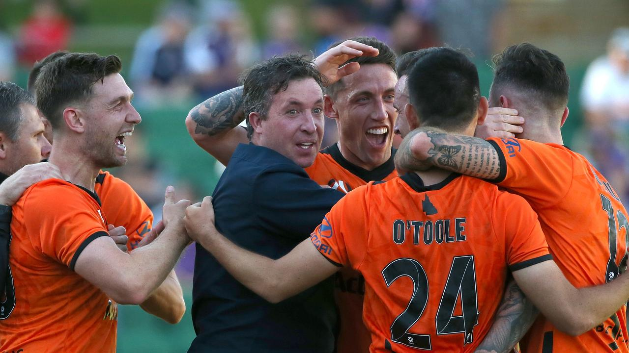 Robbie Fowler coach of the Roar celebrates with his players after a goal by Roy O'Donovan. Picture: Paul Kane/Getty Images