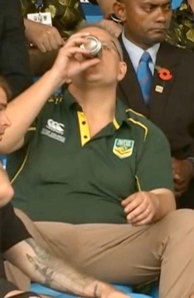 Scott Morrison drinks a beer at ANZ Stadium in Suva, Fiji.