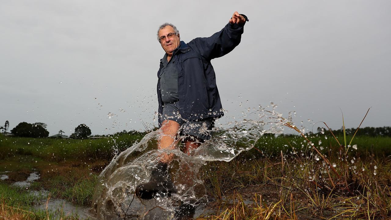 Cane farmer Paul Schembri enjoying the rain. Pic Peter Wallis