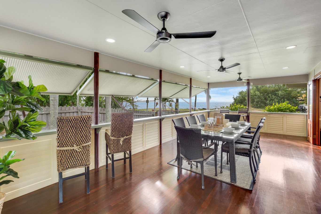 RECORD RECOVERY: The outdoor entertaining area overlooking the beach at 15 Swan Street, Slade Point.