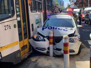 Cop car wrecked in tram bingle