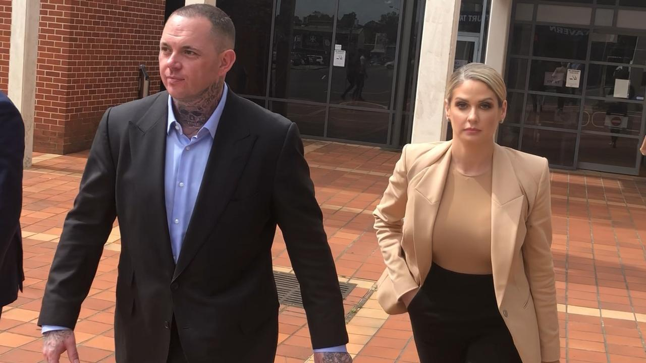 Monstr Clothing founder and accused bikie Shane Ross leaving Campbelltown Court today with his wife.