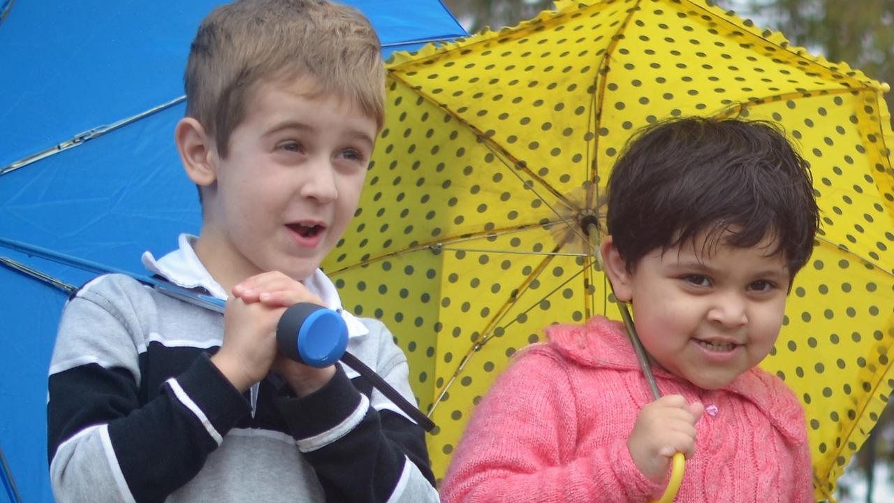 NO RAIN IN SIGHT: Kids in the rain at Warwick's Community Kindergarten.