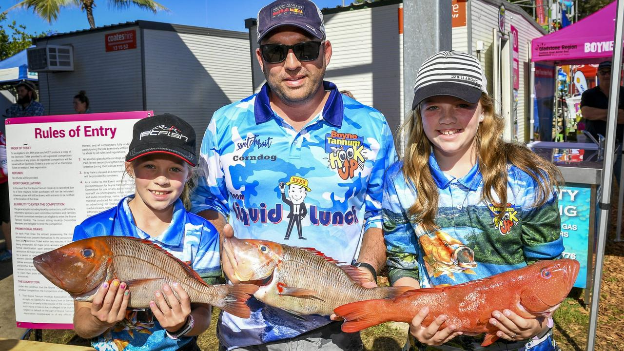 Andy Cornelissen with Olivia, 9 and Sophie, 11 with red throat and coral trout at the afternoon weigh-in on Day 3 of the 2019 Boyne Tannum HookUp.