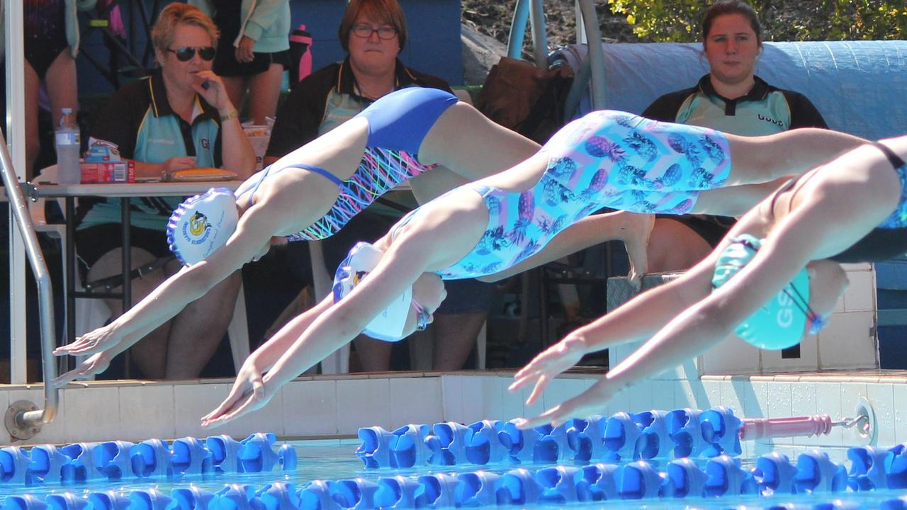 L-R: Gladiators Ysabelle Scott and Sophie Walsh take off for their 25m freestyle sprint