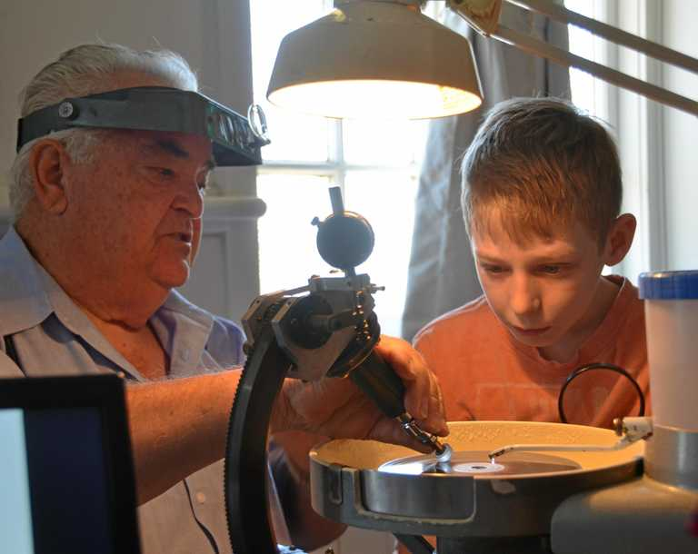 ANCIENT CRAFT: George Weier faceting a precious stone for Sebastian Catling at the Monto Lapidary Club open day.