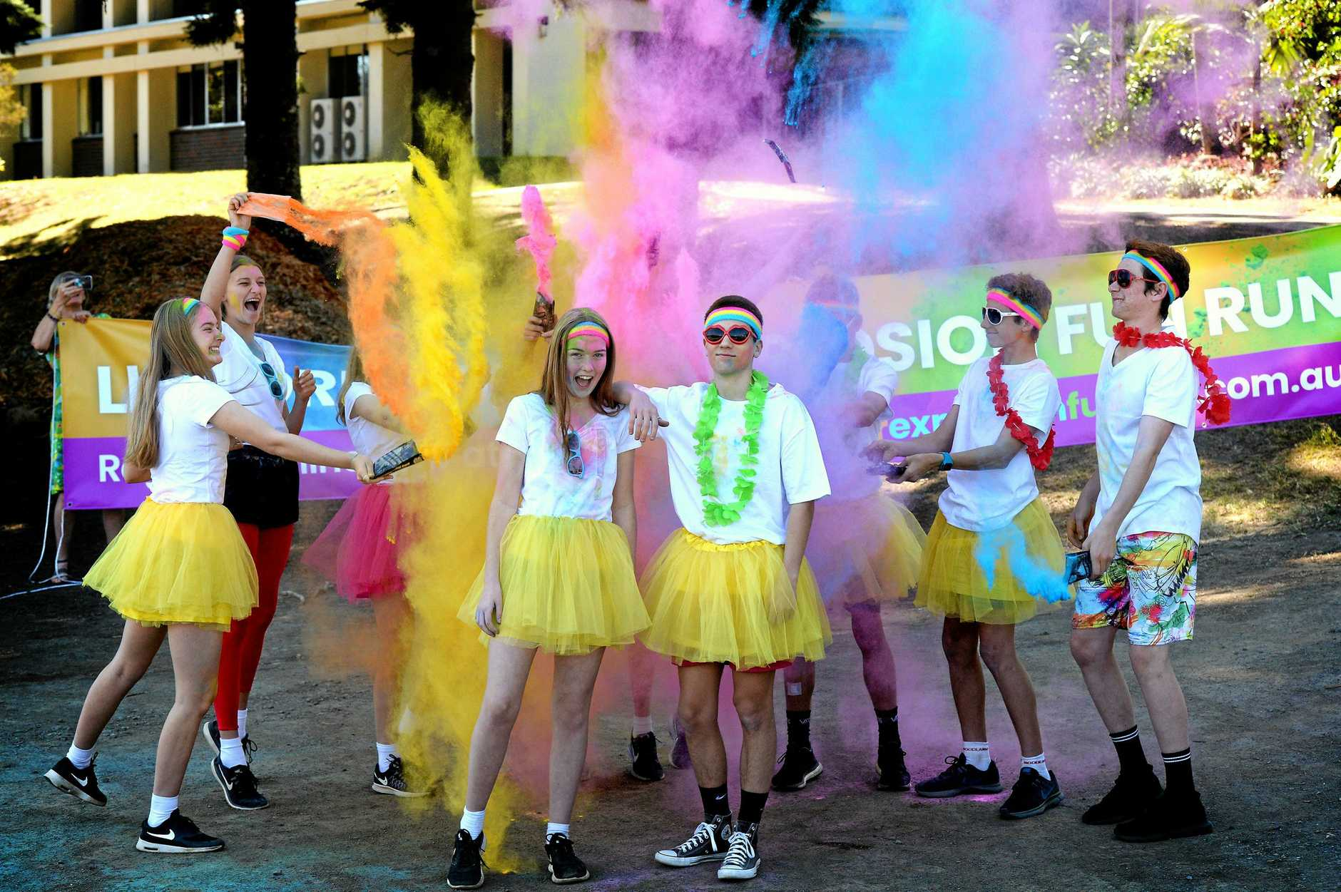 EXPLOSION: Lismore school students Mimi O'Reilly, 13, and Jackson Cheong, 15, with other students ahead of the 2018 Lismore Colour Explosion Fun Run.