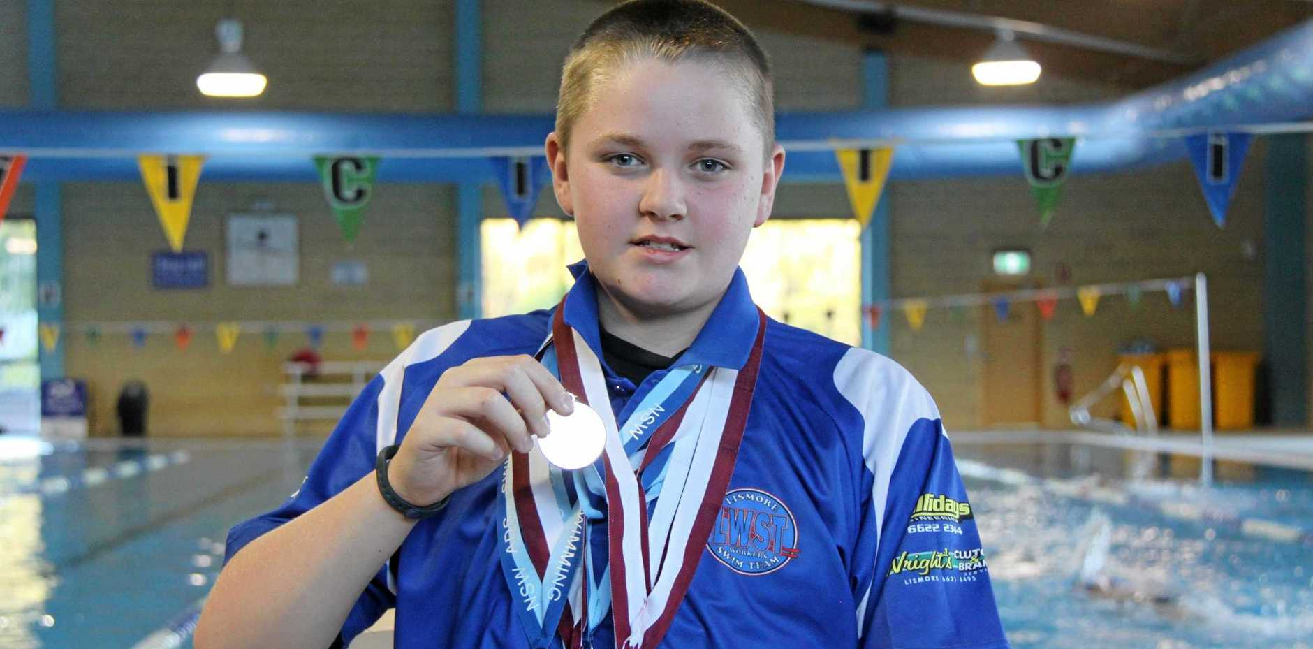 FISTFUL OF MEDALS: Lismore Workers Swim Team member Ben Auckram, 15, claimed five gold medals at the 2019 NSW multi-class state titles in Sydney.