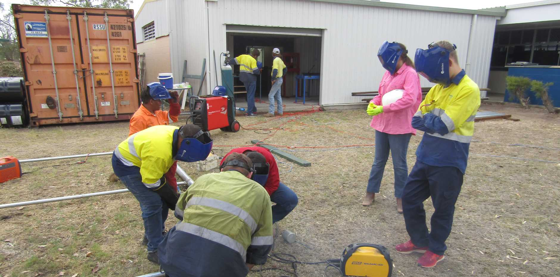 TRADIES: Students from Collinsville State High School were given the opportunity to construct and erect a discus cage with the guidance of trained tradespeople.