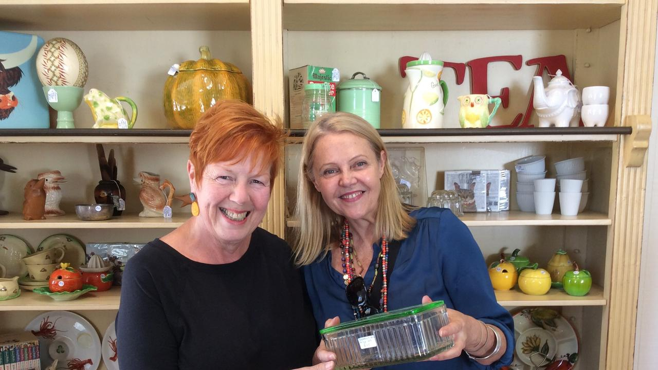 HIDDEN TREASURES: Noosa MP Sandy Bolton called into Kin Kin Depot to inspect the depression glassware collectables with the gift shop's owner, Jo Wiles.