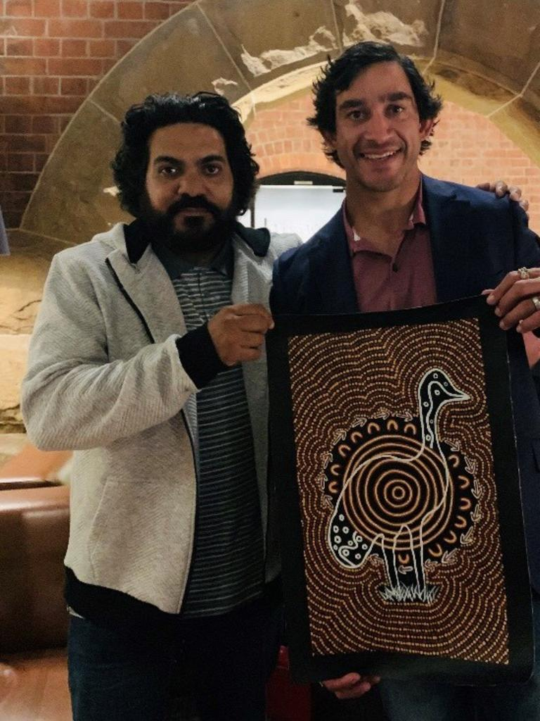 TRAIL BLAZERS: Wayne Martin of Nguram-Bang Aboriginal Art alongisde Johnathon Thurston presenting the design of the 2019 NRL premiership rings.