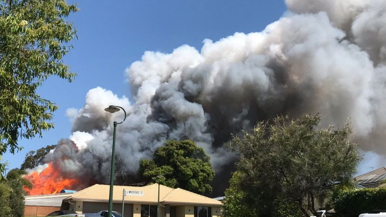 A two-storey house in Mango Hill has been extensively damaged in a fire this afternoon. Picture: Isabelle Mullen/7 News
