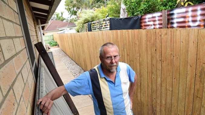 OF-FENCE-IVE: extraordinary spat over backyard escalates