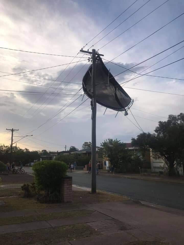 Trampoline caught in powerlines at Raceview.