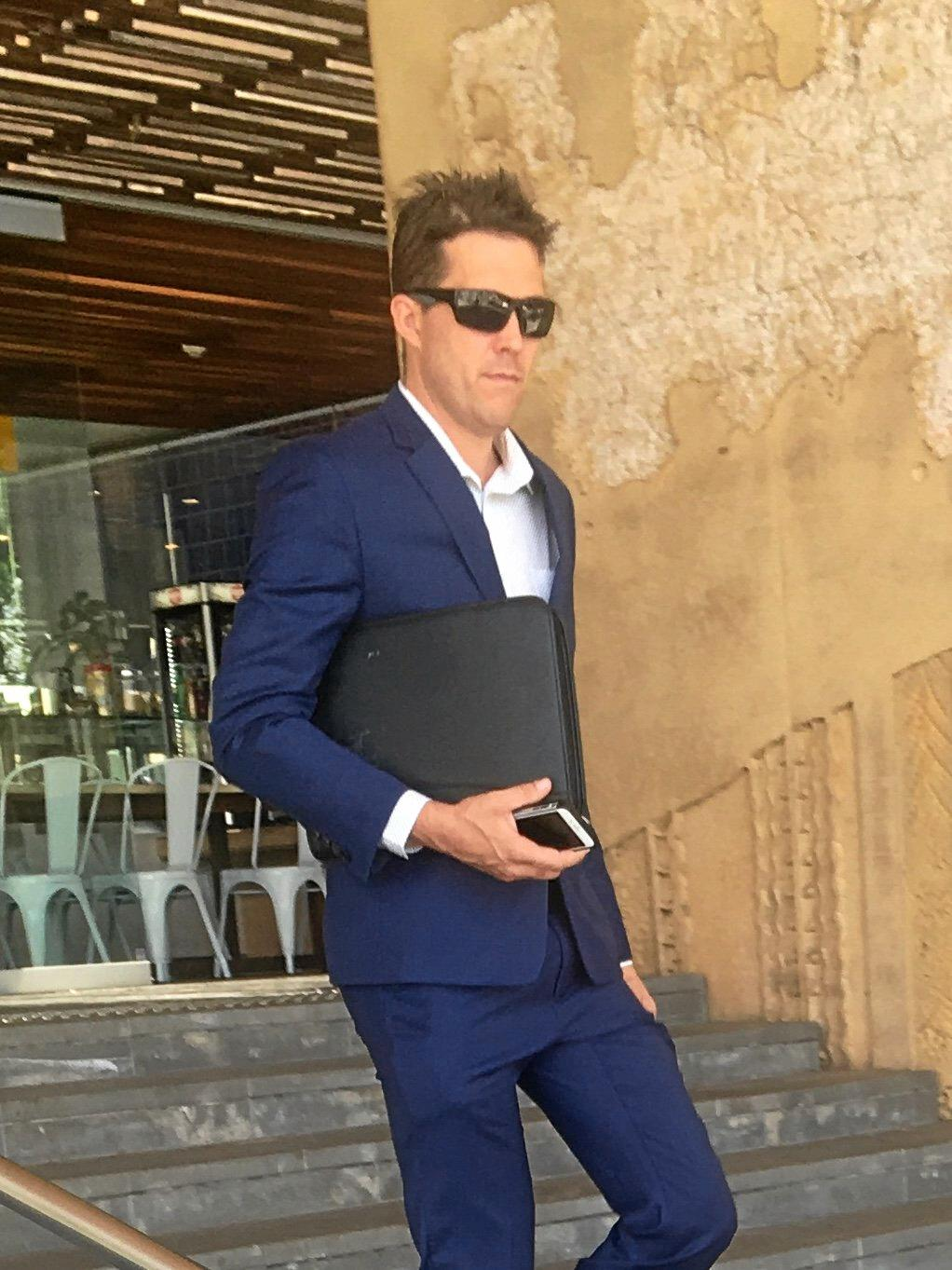 IN ON THE ACT: Anthony Robert Webb leaves Ipswich Courthouse after admitting to possession of handcuffs, tasers and police epaulettes. He later admitted to an addition charge of impersonating police.
