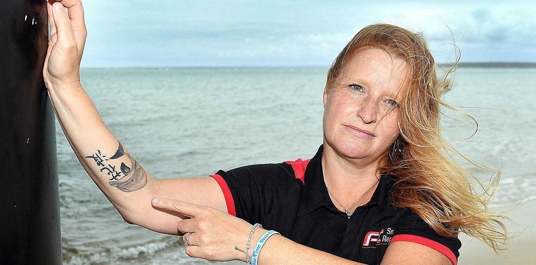 WORN WITH PRIDE: Dolphin activist Liz Carter shows her dolphin tattoo.