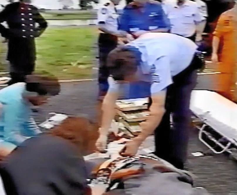 Video footage captures Dr Maureen Cuffe and Dr Ray Jones (both to the left) provide medical treatment to Yvonne at the Cowper crash site.