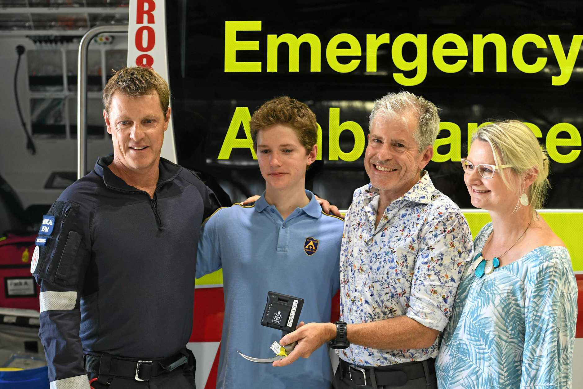 Connor Meldrum, Kim Goodrick (mum) and Dr David Meldrum (dad), meet New South Wales Ambulance Critical Care Paramedic Rolly Murcott and praise the medical and retrieval team from the Westpac Life Saver Rescue Helicopter who rescued Connor and helped save his life.