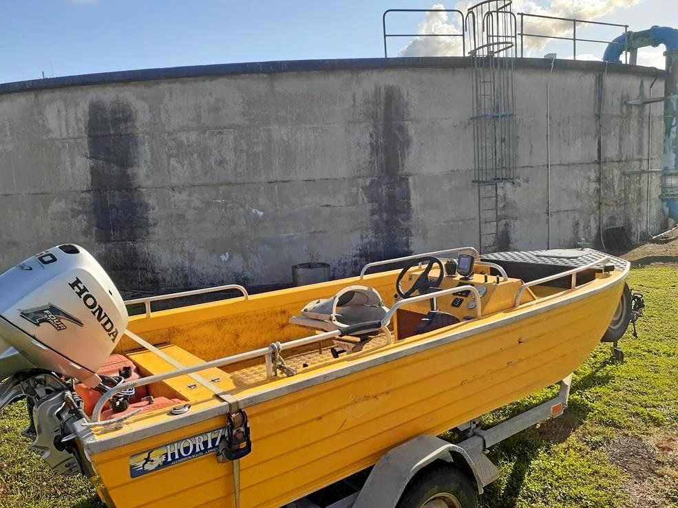 This former SES boat is up for auction next week at Whitsunday Regional Council's surplus goods auction.