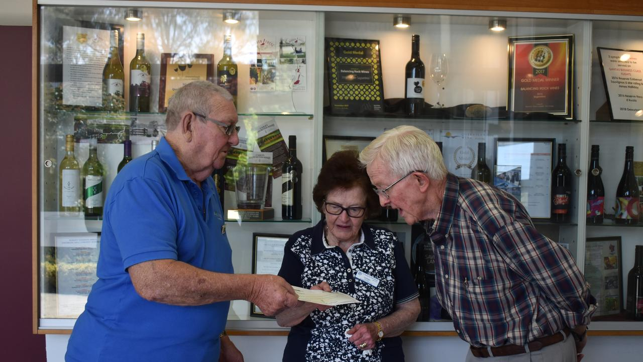 The Village Redcliffe organiser Ron Williams handing over the cheque to Vinnies President Carmel Mahoney and Treasurer Mark Bathersby.