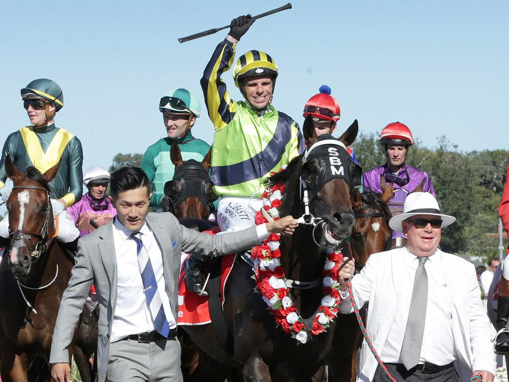 Harvey Green (right) returns to scale with New Zealand Derby winner Crown Prosecutor.
