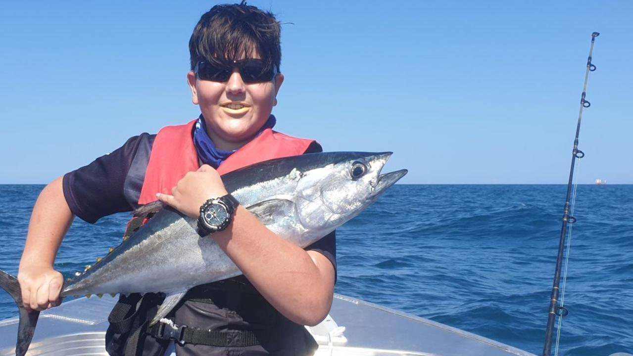 Travis Bryant, 13, with a blue fin tuna caught off Mackay Harbour.