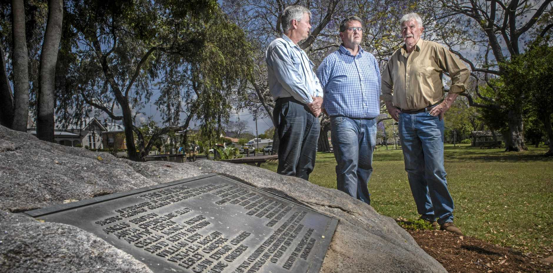 David Bancroft, Richie Williamson and Bryan Robins look over the Cowper Memorial at See Park in preparation for the 30th anniversary of the Cowper Bus Crash.