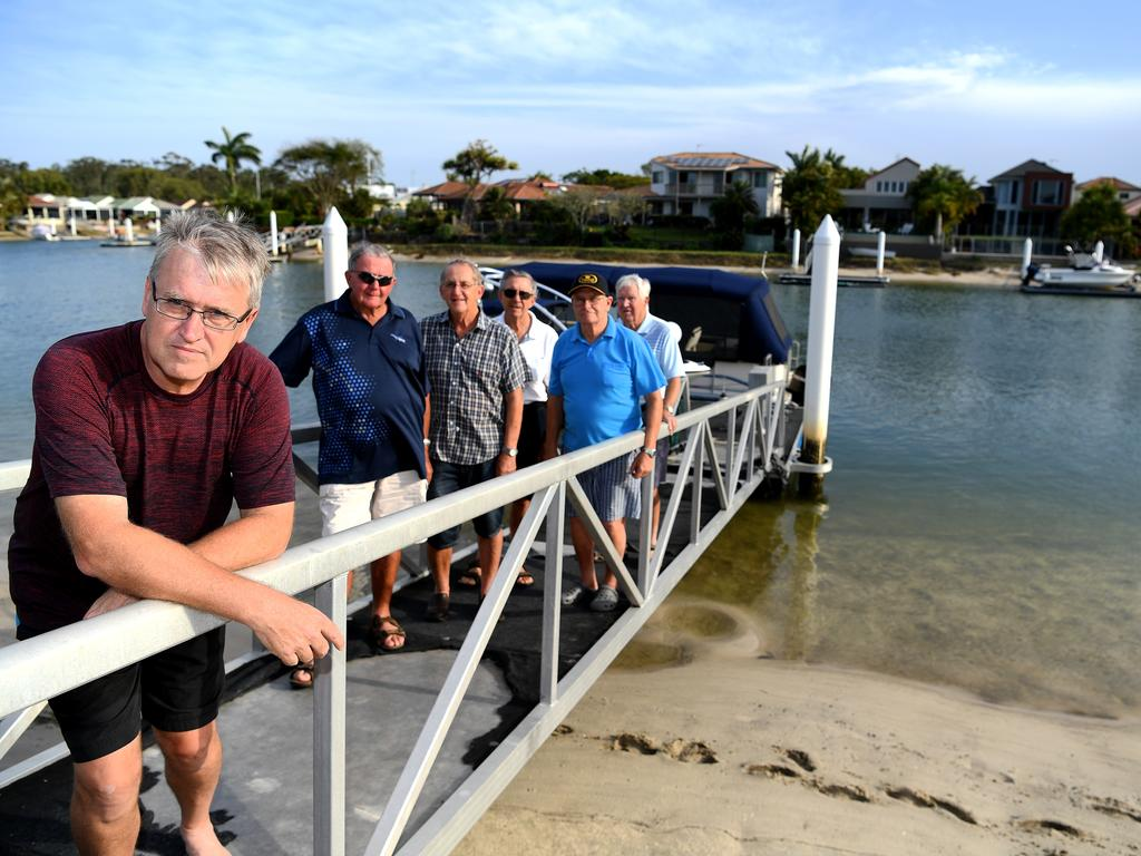 Some of the residents of Maroochy Waters are unhappy with the condition of the canals and want action from the Council. Robert Herd (front) and local residents want action from the Council.