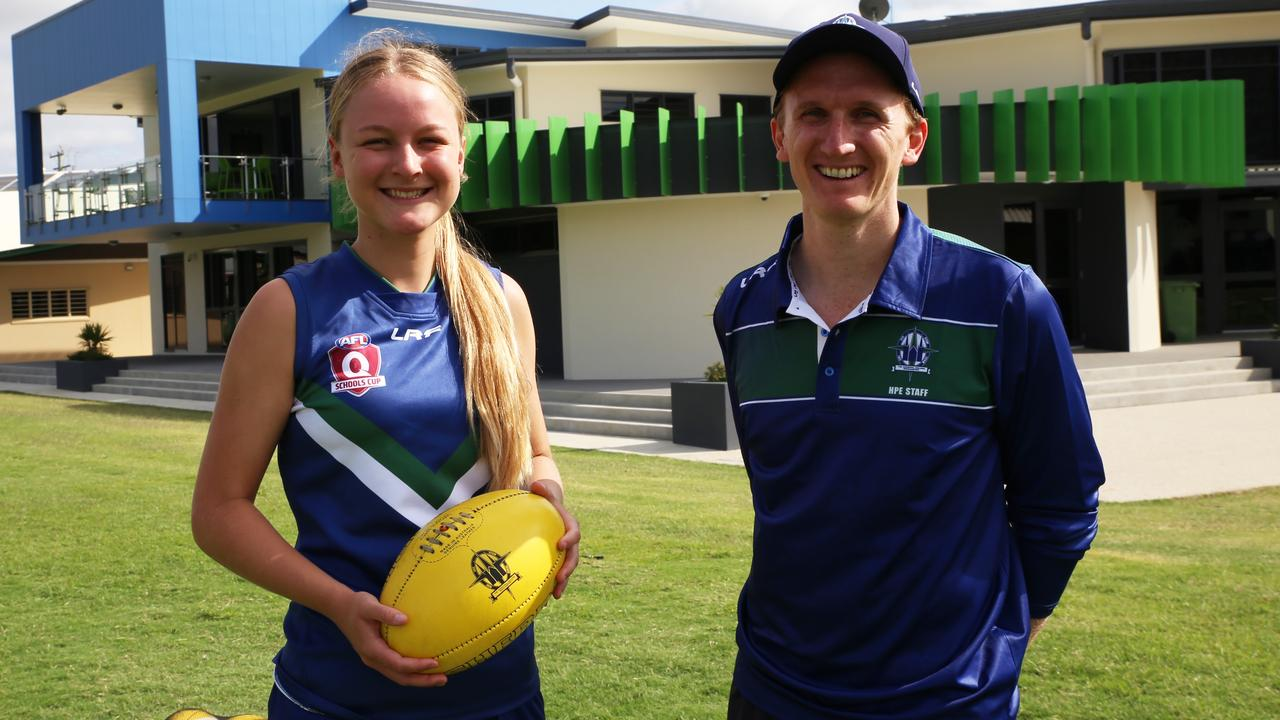 READY TO GO: TCC senior girls captain Sara-Jane O'Grady and coach Michael Rose are excited for today's AFL Queensland Schools Cup preliminary final against Miami State High. Picture: PAULINE CROW.