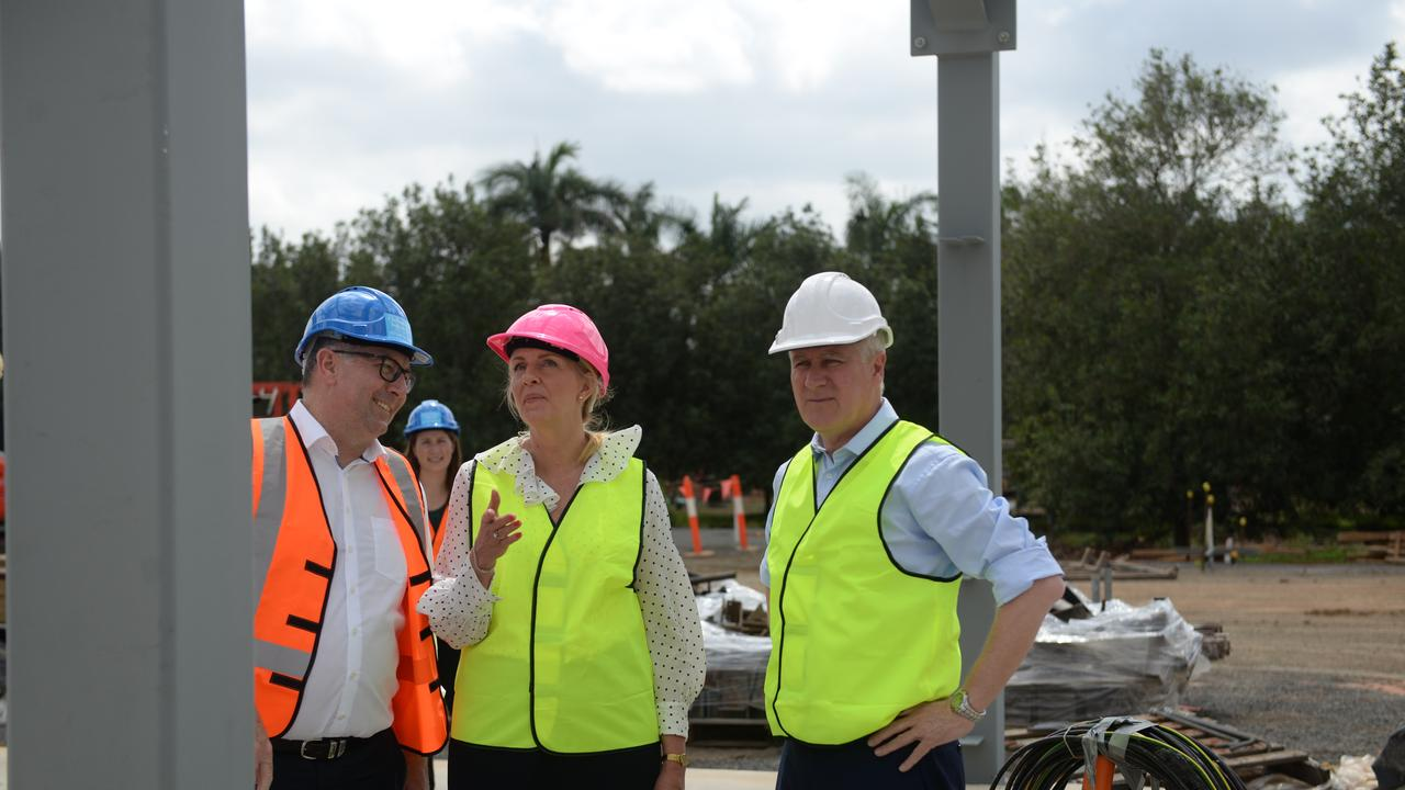 Hinkler MP Keith Pitt and Deputy Premier Michael McCormack flank director of Macadamias Australia Janelle Gerry on a visit to inspect the progress of Macadamias Australia's new facility.