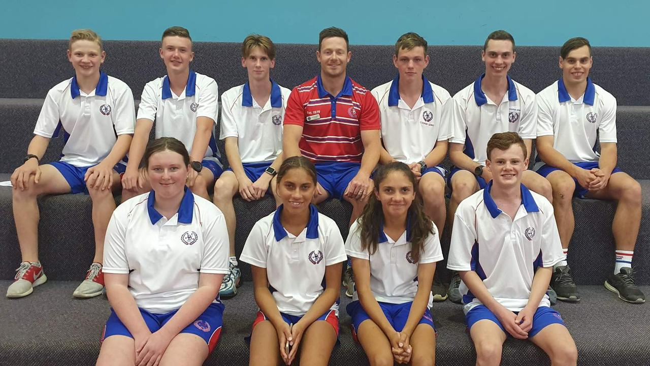 VYING FOR GLORY: Nathan Rogers with members of the Darling Downs athletics side selected to compete in Cairns over the weekend. (Back: Braedan Galloway, Kehan Edwards, Tom Denny, Nathan Rogers, Cooper Seng, Lachlan, Sam Ogden. Front: Taylah Bogg, Kiah Murray, Danika Murray, William Thornton).