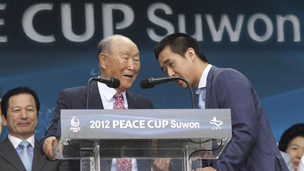 Sun Myung Moon and his son Hyung-jin Moon in 2012. Picture: AP Photo/Ahn Young-joon