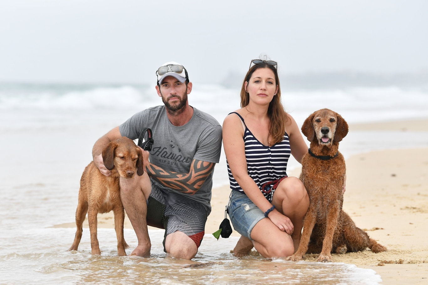 Imbi Tonisson and Jarrad Finlayson started a petition to oppose the removal of the off leash area at Bokarina Beach between access 245 and 247. Pictured with their dogs Ollie and Luna. Photo Patrick Woods / Sunshine Coast Daily.
